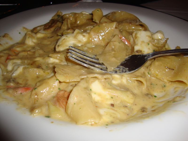 Fresh pappardelle pasta with creamy artichoke sauce