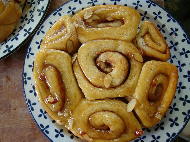 Hot and fresh from the oven- sticky buns with honey almond slurry