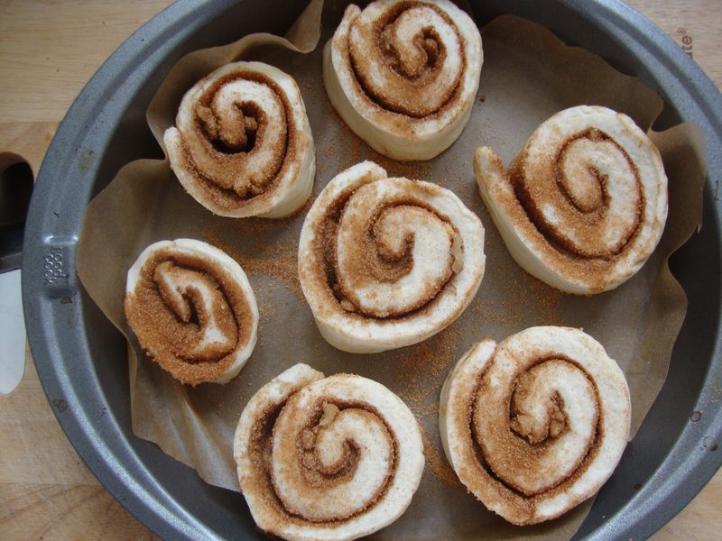 Cinnamon rolls, 1-inch apart, on parchment paper