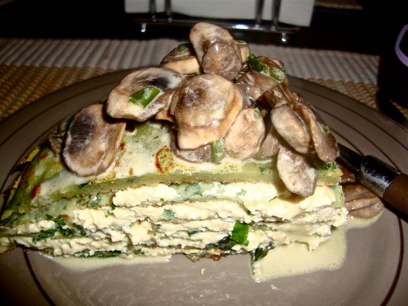 Spinach crepe cake with herbed ricotta and mushrooms