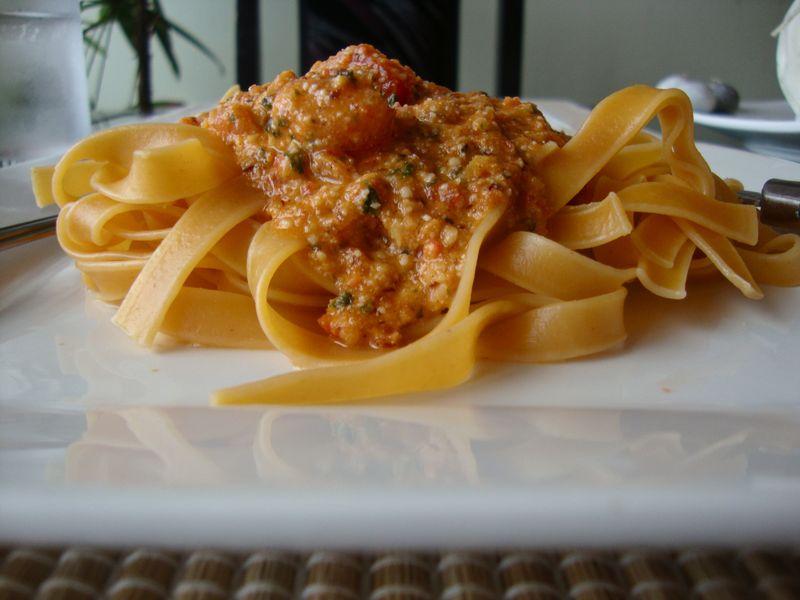 Tomato tagliatelle with tomato-almond pesto