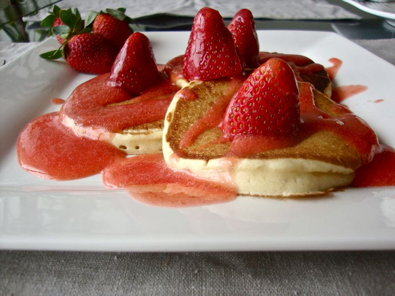 Orange-scented buttermilk pancakes with strawberry coulis