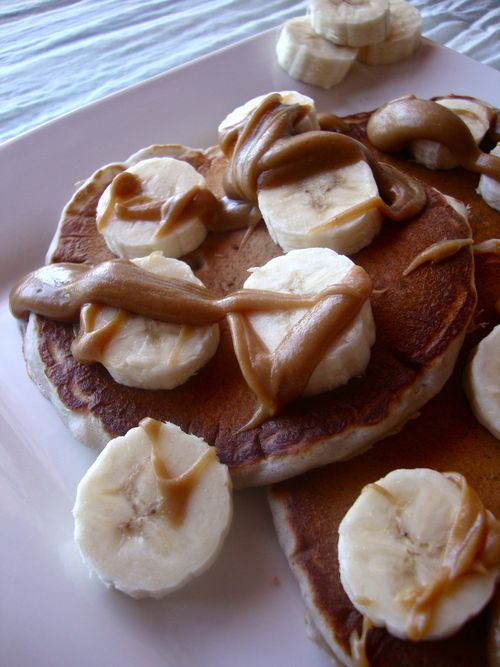 Blueberry yogurt pancakes with bananas and peanut butter syrup