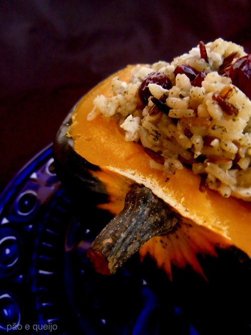 Roasted acorn squash stuffed with wild rice, dried cranberries, and feta